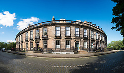 View of townhouses on historic Carlton Terrace  below Calton Hill in Edinburgh, Scotland, United Kingdom