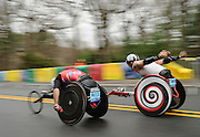 Rafael Botello Jimenez (left), of Spain, pulls ahead of another pushrim wheelchair competitor during the 119th running of the Boston Marathon along Central Street in Wellesley, April 20, 2015.   (Wicked Local Photo/James Jesson).