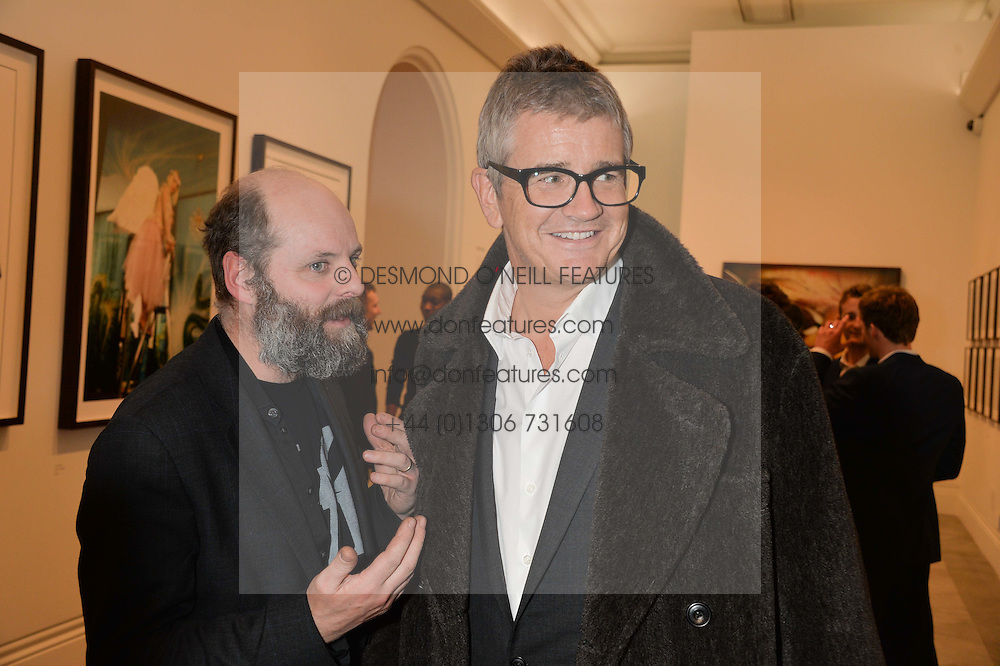 Left to right, GAVIN TURK and JAY JOPLING at a private view of photographs by David Bailey entitled 'Bailey's Stardust' at the National Portrait Gallery, St.Martin's Place, London on 3rd February 2014.
