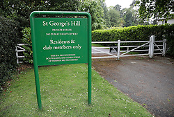 © London News Pictures. 21/05/2016. Weybridge, UK. A gated entrance to St George's Hill estate near Weybridge in Surrey where the body of a woman in her 30's was discovered by paramedics this morning (Sat). Photo credit: Peter Macdiarmid/LNP