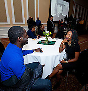 George Appiah, left, and Kaitlin Wilson ask each other questions as a way of breaking the ice and meeting people at the All Black Affair at Baker University Center Ballroom at Ohio University on Friday, January 29, 2016. © Ohio University / Photo by Sonja Y. Foster