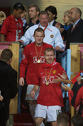 MOSCOW, RUSSIA - Wednesday, May 21, 2008: Manchester United's Paul Scholes, Wayne Rooney and manager Alex Ferguson walk down the steps after collecting their winners' medals during the UEFA Champions League Final against Chelsea at the Luzhniki Stadium. (Photo by David Rawcliffe/Propaganda)