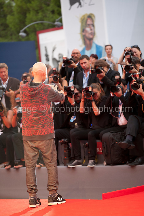 Jonathan Demme faces photographers with his Persol Tribute to Visionary Talent Award at the 72nd Venice Film Festival, Thursday September 3rd 2015