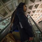 WASHINGTON, DC - DEC 11: Dinia Lovo Marquez, an 18-year-old senior at Bell Multicultural High School in Washington, DC, takes the metro to her after school job as a janitor at the U.S. Department of Education, December 11, 2013. An immigrant from El Salvador, she one of 7 children being raised by her mother Maria, a cook at the Willard Hotel. Dinia wants to be the first in her family to attend college. (Photo by Evelyn Hockstein/For The Washington Post)