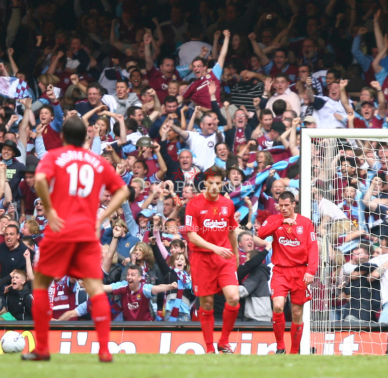 CARDIFF, WALES - SATURDAY, MAY 13th, 2006: Liverpool's Jamie Carragher looks dejected as West Ham United score a fluke goal to take the lead 3-2 with only minutes remaining during the FA Cup Final at the Millennium Stadium. (Pic by David Rawcliffe/Propaganda)