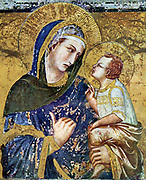 The Madonna dei Tramonti is a 1330 Madonna fresco by the Italian artist Pietro Lorenzetti. It is located in the Basilica of San Francesco d'Assisi, in Assisi, Italy. Pietro Lorenzetti (or Pietro Laurati; c. 1280 – 1348) was an Italian painter, active between approximately 1306 and 1345