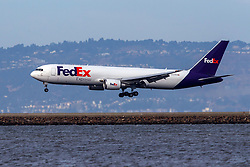 Boeing 767-3S2F(ER) (N127FE) operated by FedEx landing at San Francisco International Airport (KSFO), San Francisco, California, United States of America
