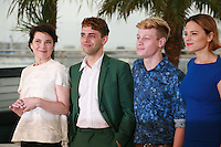 Anne Dorval, Director Xavier Dolan, Antoine-Olivier Pilon and Suzanne Clément at the photo call for the film Mommy at the 67th Cannes Film Festival, Thursday 22nd May 2014, Cannes, France.