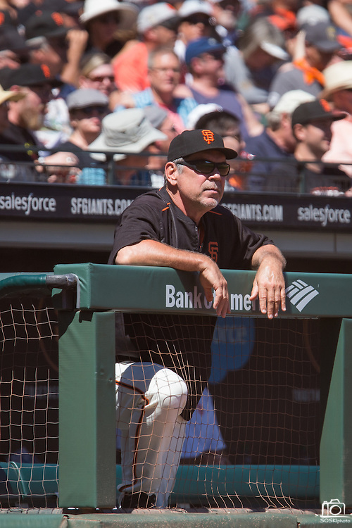 San Francisco Giants manager Bruce Bochy (15) watches from the dugout during a game against the Arizona Diamondbacks at AT&T Park in San Francisco, Calif., on August 31, 2016. (Stan Olszewski/Special to S.F. Examiner)