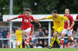 Bobby Reid of Bristol City is closed down by Brislington's Jason Llama - Photo mandatory by-line: Dougie Allward/JMP - Mobile: 07966 386802 - 05/07/2015 - SPORT - Football - Bristol - Brislington Stadium - Pre-Season Friendly