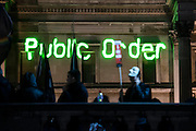 A crowd control message is displayed on the National Gallery by the police at the start - The annual Million Mask March bonfire night protest started in Trafalgar Square and headed to Westminster where it splintered. The march was organised by Anonymous UK and marchers wore the trademark V for Vendetta, Guy Fawkes masks. The police had placed tight restrictions on the route after trouble last year but, after a brief kettle, seemed happy to let the crowd filter in different directions.