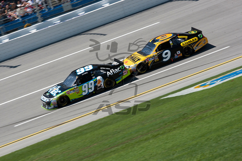 TALLADEGA, AL - APR 17, 2011: Carl Edwards (99) and Marcos Ambrose (9)draft during the  at the Talladega Superspeedway in Talladega, AL.