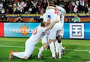 June 12, 2010; Rustenburg, SOUTH AFRICA; England midfielder Steven Gerrard (4) celebrates his goal with teammates during group C play against USA at Royal Bafokeng Stadium.  Mandatory Credit: Jim Brown-US PRESSWIRE