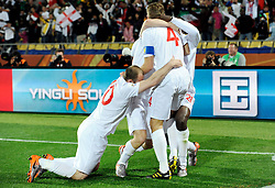 June 12, 2010; Rustenburg, SOUTH AFRICA; England midfielder Steven Gerrard (4) celebrates his goal with teammates during group C play against USA at Royal Bafokeng Stadium.  Mandatory Credit: Jim Brown-US PRESSWIRE
