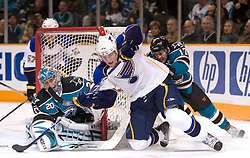 January 6, 2010; San Jose, CA, USA; San Jose Sharks goalie Evgeni Nabokov (20) stops St. Louis Blues center T.J. Oshie (74) during the third period at HP Pavilion.  San Jose defeated St. Louis 2-1 in overtime.