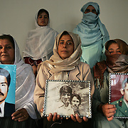15th August 2007.Kabul, Afghanistan.A group of mothers, sisters, wives and daughters of Afghanis who have disappeared over the last 25 years holding photographs of their relatives in Kabul, Afghanistan on the 15th August 2007. The women are forming an action group to try and get answers from the government as to the fate of their missing relatives. A number of mass graves have been discovered in Afghanistan including a new one on the outskirts of Kabul.