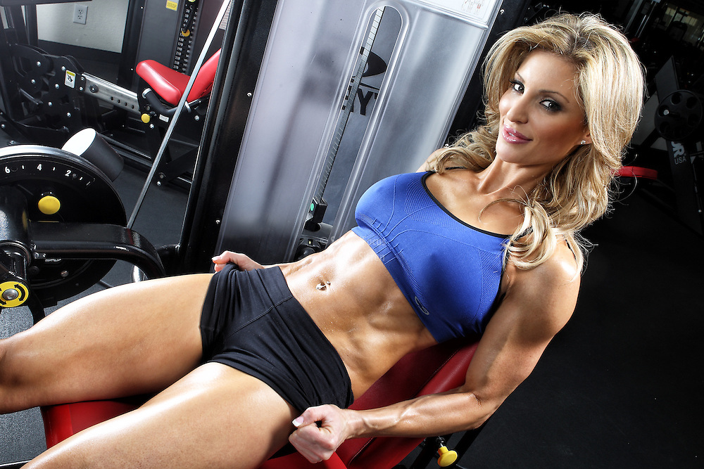 Randalene Sergent doing leg extensions in the gym