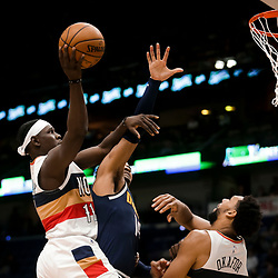 Jan 30, 2019; New Orleans, LA, USA; New Orleans Pelicans guard Jrue Holiday (11) shoots over Denver Nuggets guard Gary Harris (14) during the second half at the Smoothie King Center. Mandatory Credit: Derick E. Hingle-USA TODAY Sports