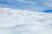 A hillside covered in snow.