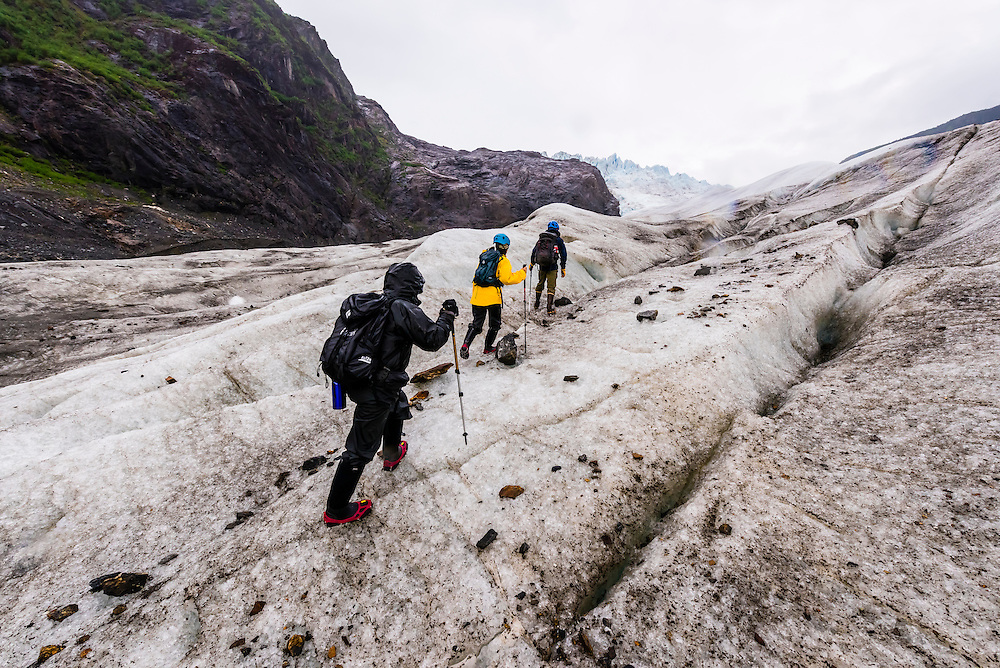Walking on the Mendenhall Glacier (with ice crampons) on a Glacier tour with Above & Beyond Alaska, Juneau, Alaska USA.