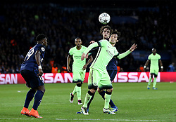 David Silva of Manchester City and Adrien Rabiot of Paris Saint-Germain watch the ball - Mandatory by-line: Robbie Stephenson/JMP - 06/04/2016 - FOOTBALL - Parc des Princes - Paris,  - Paris Saint-Germain v Manchester City - UEFA Champions League Quarter Finals First Leg