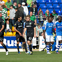 St Johnstone v Celtic....15.09.12      SPL  <br /> Nigel Hasselbaink and Gregory Tade celebrates victory at full time as Celtic's Thomas Rogne, James Forrest and Lassad Nouioui trudge off<br /> Picture by Graeme Hart.<br /> Copyright Perthshire Picture Agency<br /> Tel: 01738 623350  Mobile: 07990 594431