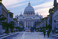 View of St Peters Basilica from lamp lined street at sunset Vatican City Rome Italy