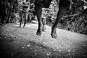 Children jump rope in a rural hamlet outside Yangon, Myanmar