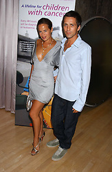 JADE JAGGER and DAN WILLIAMS at party in aid of cancer charity Clic Sargent held at the Sanderson Hotel, Berners Street, London on 4th July 2005.<br /><br />NON EXCLUSIVE - WORLD RIGHTS