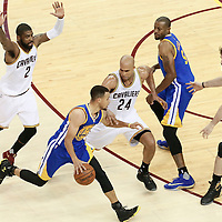 10 June 2016: Cleveland Cavaliers forward Richard Jefferson (24), Cleveland Cavaliers guard Kyrie Irving (2) and Cleveland Cavaliers forward Kevin Love (0) defend on Golden State Warriors guard Stephen Curry (30) next to Golden State Warriors forward Andre Iguodala (9) during the Golden State Warriors 108-97 victory over the Cleveland Cavaliers, during Game Four of the 2016 NBA Finals at the Quicken Loans Arena, Cleveland, Ohio, USA.