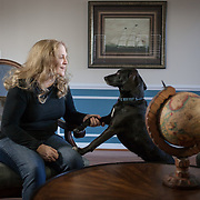 Jenifer Higgins Clark, with her dog, Shadow, insider her Dunkirk, MD, home where she runs her business, Jenifer Clark's Gulfstream.  A satellite oceanographer for over 30 years, she retired from the National Oceanic and Atmospheric Administration and started her own business using infrared imagery, satellite altimetry and surface isotherm data to support boaters, fishers, sailing races as well as rescue operations along the east coast.  For University of Mary Washington