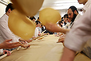 Teams of Orthodox Jewish teenage boys use rolling pins to flatten the matza bread for Passover before it goes into the oven in a room at the back of Bethune Road synagogue. The baking process from start to finish has to be completed within 18 minutes for it to be Kosher.