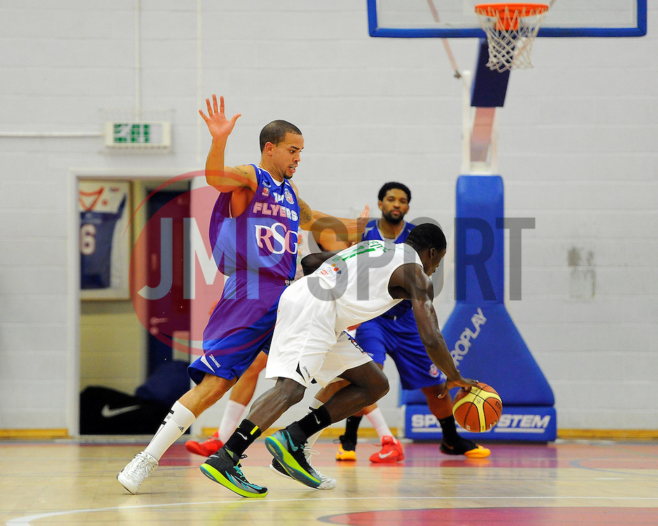 Bristol Academy Flyers' Doug McLaughlin-Williams battles for the ball with Plymouth Uni Raiders' Nicholas George  - Photo mandatory by-line: Joe Meredith/JMP - Mobile: 07966 386802 - 27/09/2014 - SPORT - Basketball - Bristol - SGS Wise Campus - Bristol Academy Flyers v Plymouth Uni Raiders - British Basketball League