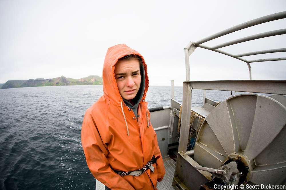 Commercial halibut fishing deckhand, Claire Laukitis, while fishing in the Aleutian Islands, Alaska.