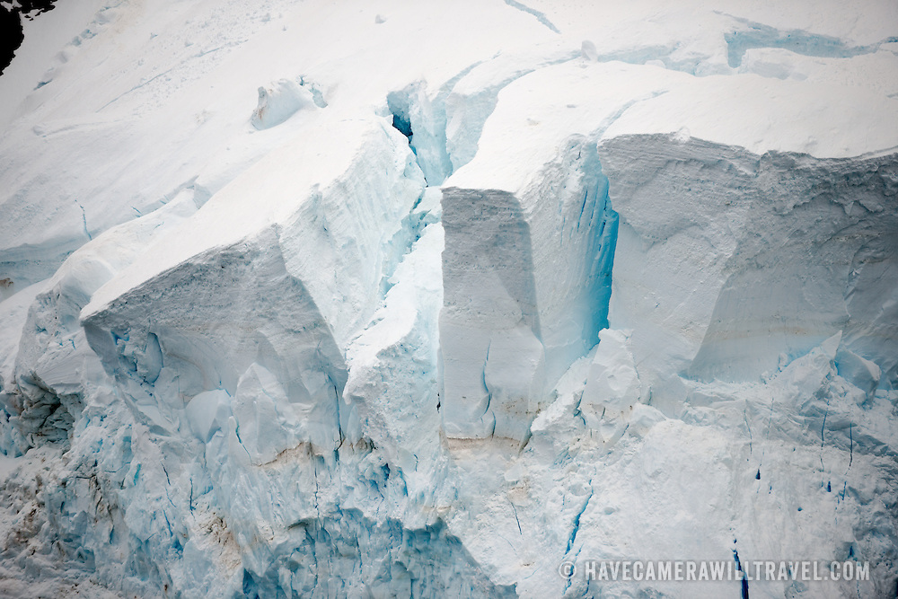 """A glacier reaches down to the waterline of the Lemaire Channel on the Antarctic Peninsula's western side. The Lemaire Channel is sometimes referred to as """"Kodak Gap"""" in a nod to its famously scenic views."""