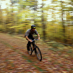 Mountain Biking on an old logging road near Loon Mountain in Lincoln.  Fall.  White Mountain N.F., NH