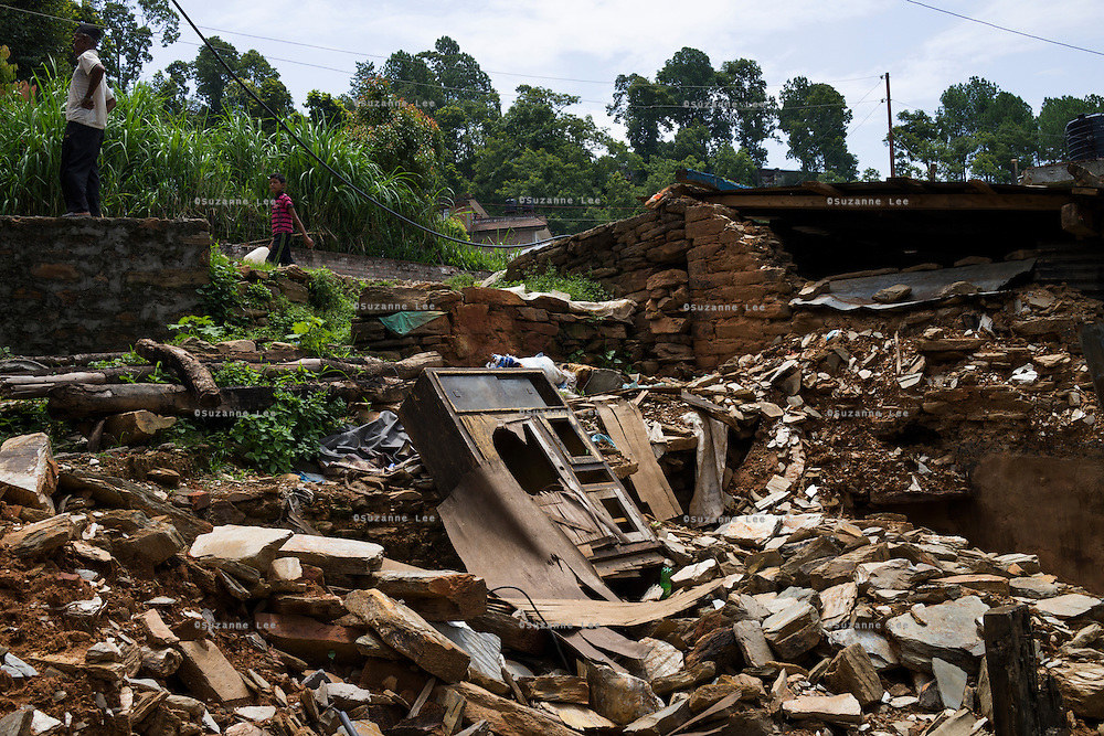 The rubble of what used to be the family home of the three girls Monika (7), Aastha (6) and Sapana Baniya (2 months) in Chautara, Sindhupalchowk, Nepal on 29 June 2015. Aastha was buried under the rubble together with her mother but Aastha survived while her mother died on the spot. As their father Ratna Baniya (28) cannot care for the children on his own, SOS Childrens Villages has since been supporting the grandmother with financial and social support so that she can manage to raise the children comfortably and ensure that they will all be schooled. Photo by Suzanne Lee for SOS Children's Villages