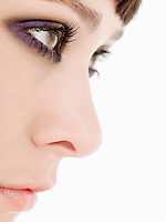 Young Woman Wearing heavy Eye Makeup side view close up