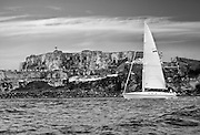 View of El Morro with passing sailing ship