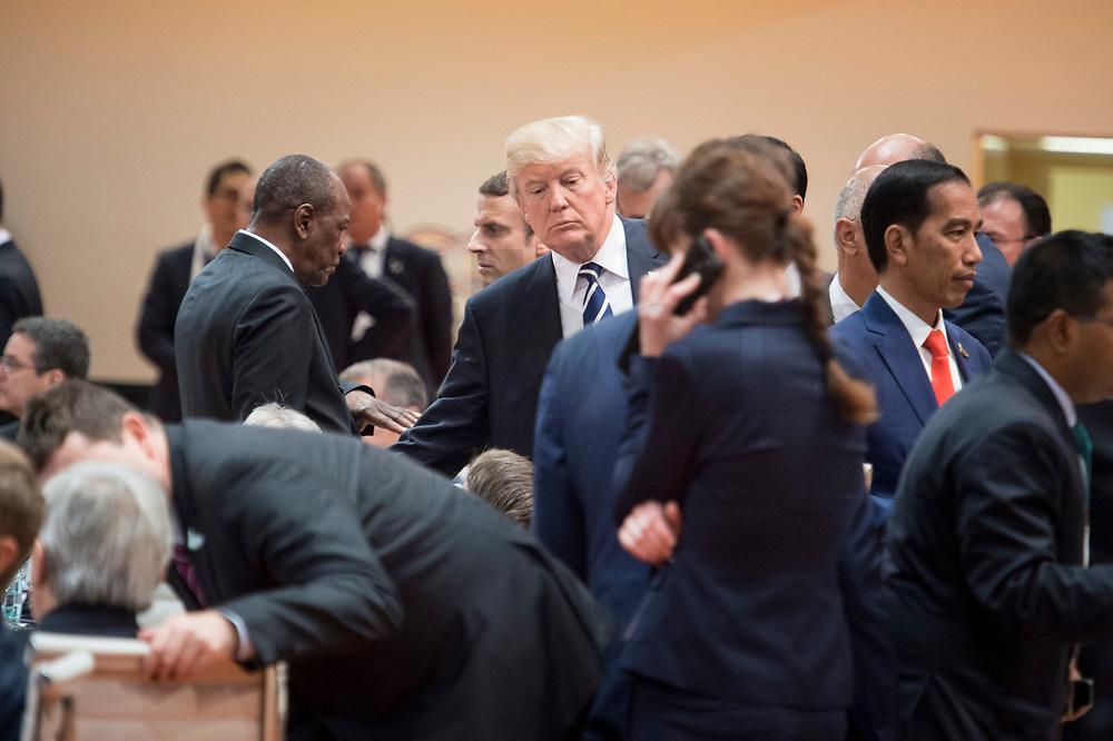 07 JUL 2017, HAMBURG/GERMANY:<br /> Donald Trump, Praesident Vereinigte Staatsn von America, USA, 1. Arbeitssitzung, G20 Gipfel, Messe<br /> IMAGE: 20170707-01-013<br /> KEYWORDS: G20 Summit, Deutschland