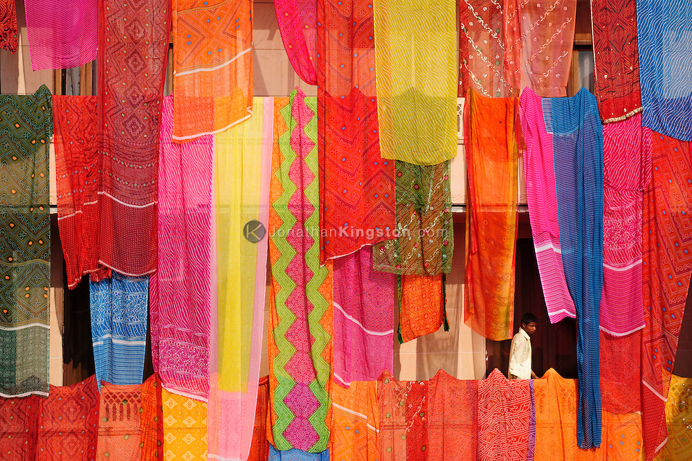 Colorful saris are draped in a courtyard in preparation for a wedding in Mathura, India.