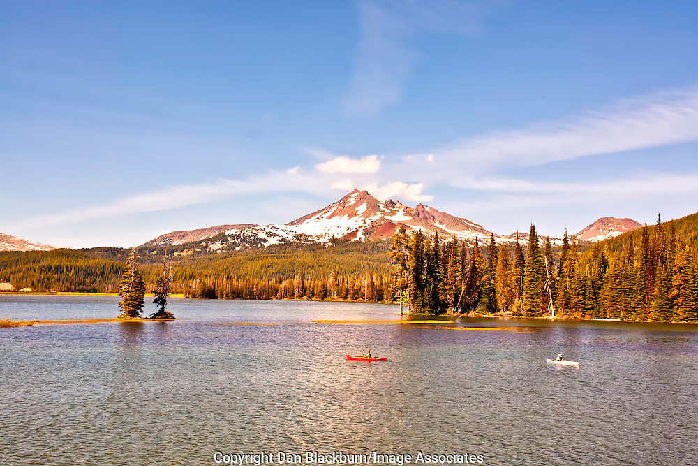 Kayakers on Sparks Lake, Oregon, with Brokentop Mountain in the background