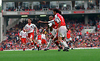 Thierry Henry shoots past Charlton Athletic goalkeeper Dean Kiely to score the 2nd Arsenal goal. Arsenal v Charlton Athletic, 26/8/00. Credit: Colorsport / Andrew Cowie.