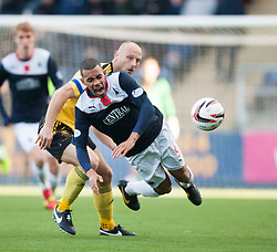 Livingston Simon Mensing and Falkirk's Phil Roberts.<br /> half time : Falkirk 1 v 0 Livingston, Scottish Championship game played today at the Falkirk Stadium.<br /> &copy;Michael Schofield.