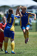 SO Sweden athlete (R) celebrates with team mates after scoring against SO Poland while football women match 7-a-side during fourth day of the Special Olympics World Games Los Angeles 2015 on July 28, 2015 at Balboa Sports Centre in Los Angeles, USA.<br /> USA, Los Angeles, July 28, 2015<br /> <br /> Picture also available in RAW (NEF) or TIFF format on special request.<br /> <br /> For editorial use only. Any commercial or promotional use requires permission.<br /> <br /> Adam Nurkiewicz declares that he has no rights to the image of people at the photographs of his authorship.<br /> <br /> Mandatory credit:<br /> Photo by © Adam Nurkiewicz / Mediasport