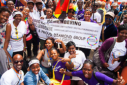London, June 28th 2014. Ugandans from the Out and Proud Diamond Group who regularly protest against their government's homophobic laws pose for a group picture as Gay Pride revellers assemble on Baker Street ahead of the parade.