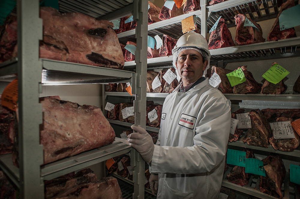 Mark Matson for American-Statesman ( 1/19/12)  Tony Sousa, Plant Manager of Lone Star Foodservice, is proud of the dry aging room at the plant.  Here, two thousand pounds of meat are aged.  The process extracts moisture from the meat, and intensifies the flavor.