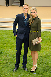 Burberry Prorsum Menswear Spring /Summer 2014 Collection.<br /> Max Chilton with guest arrives for Burberry Prorsum Menswear Spring /Summer 2014 Collection, Perks Field, Kensington Gardens, <br /> London, United Kingdom<br /> Tuesday, 18th June 2013<br /> Picture by Chris  Joseph / i-Images