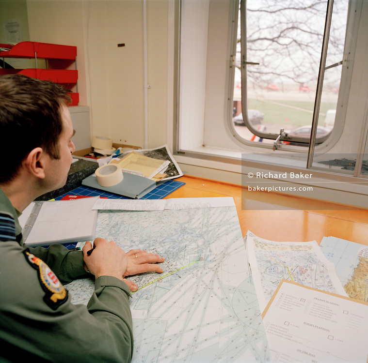 Pilot of the Red Arrows, Britain's RAF aerobatic team with flight planning duties gazes for a moment out of the window.