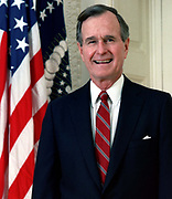 George Herbert Walker Bush (born  1924) 41st President of the United States 1989–1993. Vice President 1981–1989. Head-and-shoulders portrait with stars-and-stripes in background. American Politician Republican